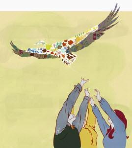 Hands reaching for bird overhead