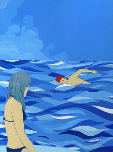 Woman watching man swim in ocean