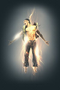 Excited man glowing with electricity