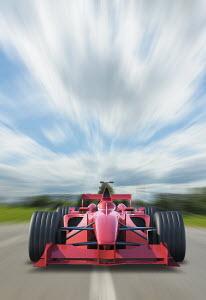 Racing car speeding on track