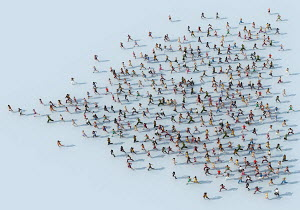 Crowd of people running forming heart shape