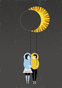 Couple holding moon and sun-shaped balloons