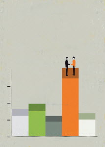 Businessmen shaking hands on top of bar graph