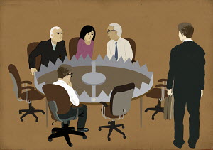 Business people sitting in meeting around bear trap conference table