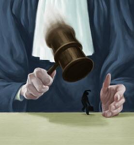 Large judge banging gavel on small businessman