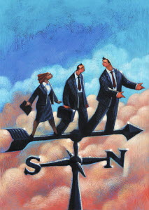Business people standing on weather vane