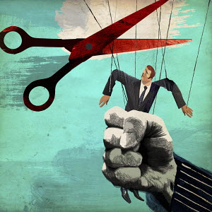 Scissors cutting puppet strings from businessman being squeezed in large fist