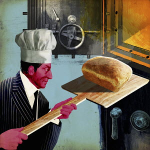 Businessman removing bread from oven bank vault