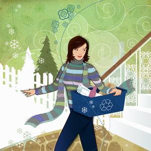 Woman carrying recycling bin in winter