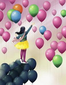 Girl on black balloons reaching for multicolor balloons in sky