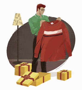 Man opening gifts and disappointed with too large sweater