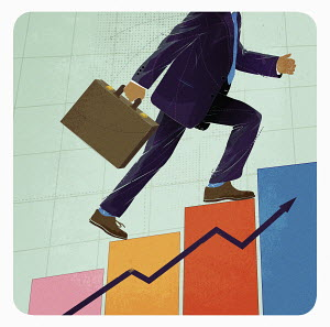 Businessman running up ascending graph