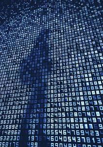 Woman's shadows on numbers on huge digital display screen wall