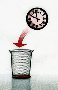 Arrow between clock and wastepaper basket - Arrow between clock and wastepaper basket