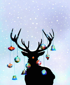 Christmas ornaments hanging from antlers of reindeer