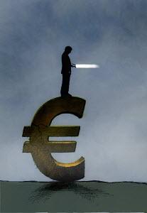 Businessman with flashlight standing on Euro symbol