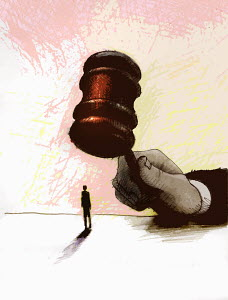 Large hand with gavel over businessman - Large hand with gavel over businessman