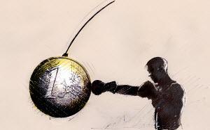 Boxer hitting Euro coin punching bag - Boxer hitting Euro coin punching bag