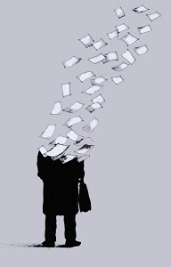 Businessman breaking up into sheets of paper