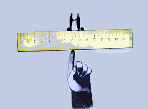 Businessmen shaking hands on ruler balanced on large finger