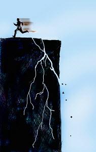 Man running away from cracking cliff
