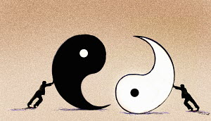 Businessmen pushing yin and yang symbols together