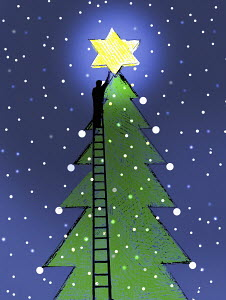 Man on ladder placing glowing star on top of large Christmas tree