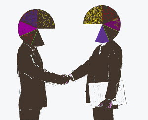 Businessmen with pie chart heads shaking hands