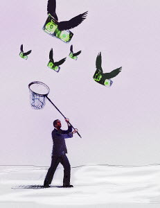 Businessman chasing flying dollars with net