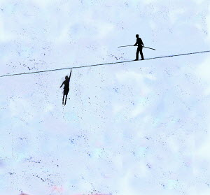 Businesswoman hanging from tightrope while businessman walks on top