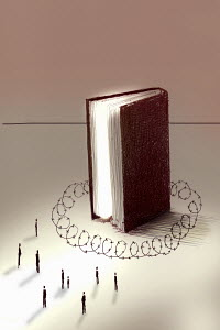 People excluded from large book surrounded by barbed wire barrier