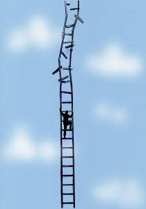 Businessman climbing crumbling ladder