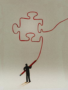 Man drawing jigsaw puzzle piece with large pencil