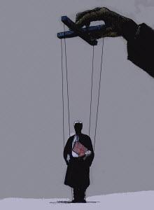 Hand of businessman manipulating puppet barrister - Hand of businessman manipulating puppet barrister