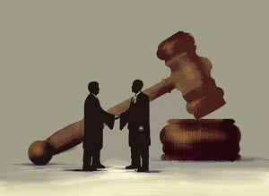 Barristers shaking hands in front of large gavel - Barristers shaking hands in front of large gavel