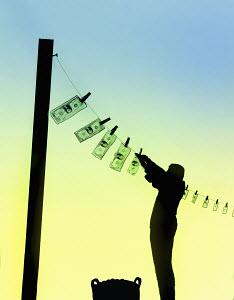 Man money laundering hanging dollar bills on washing line