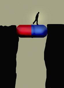 Man walking across large pill capsule bridging the gap between cliffs