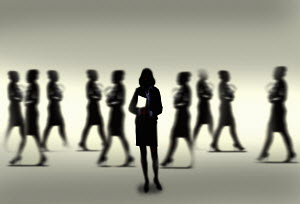 Silhouette of calm confident businesswoman standing out from the crowd