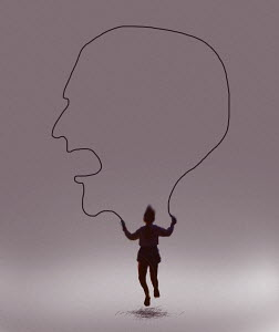 Young girl skipping with skipping rope forming outline of angry face