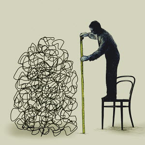 Man standing on chair measuring tangled line with tape measure