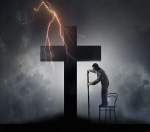 Man measuring large cross with forked lightning overhead - Man measuring large cross with forked lightning overhead