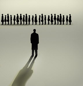 Businessman looking at queue of people waiting in line
