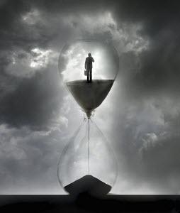 Businessman inside of hourglass