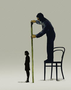 Businessman measuring height of woman with tape measure