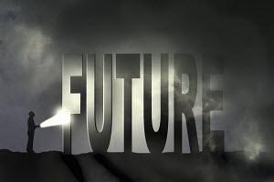 Man shining flashlight on the word future