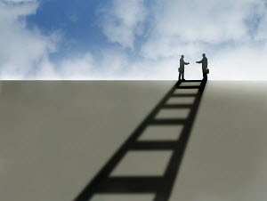 Two businessmen reaching to shake hands casting ladder shadow