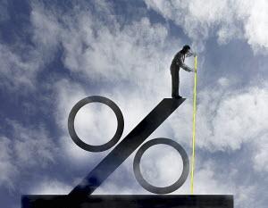 Businessman measuring size of large percentage sign