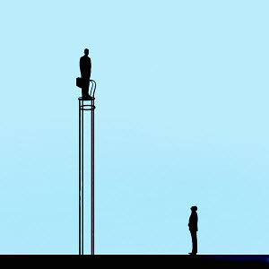 Man looking up at businessman standing on top of tall chair