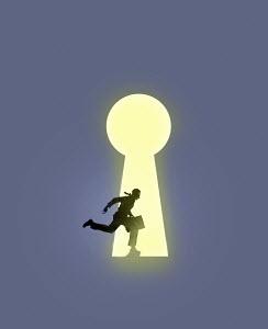 Businessman running into large illuminated keyhole