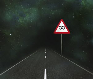 Infinity road sign beside straight empty road